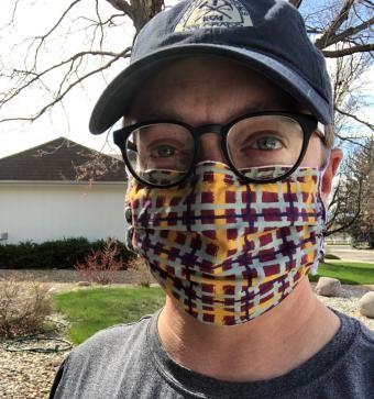 Brent Duncan modeling a mask