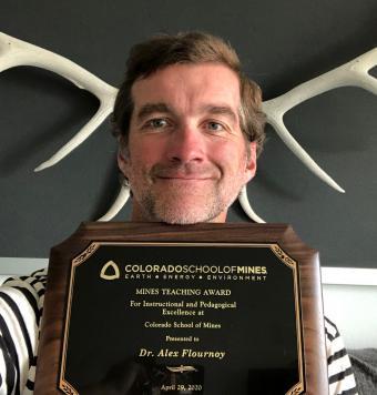 Alex Flournoy with award plaque