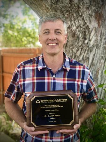 Josh Ramey with award plaque