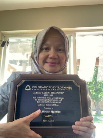 Mirna Mattjik with award plaque