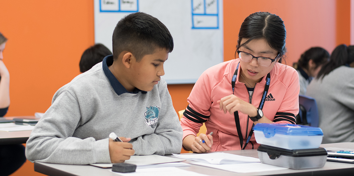 A Mines student works with a College View Middle School student during a weekly tutoring session