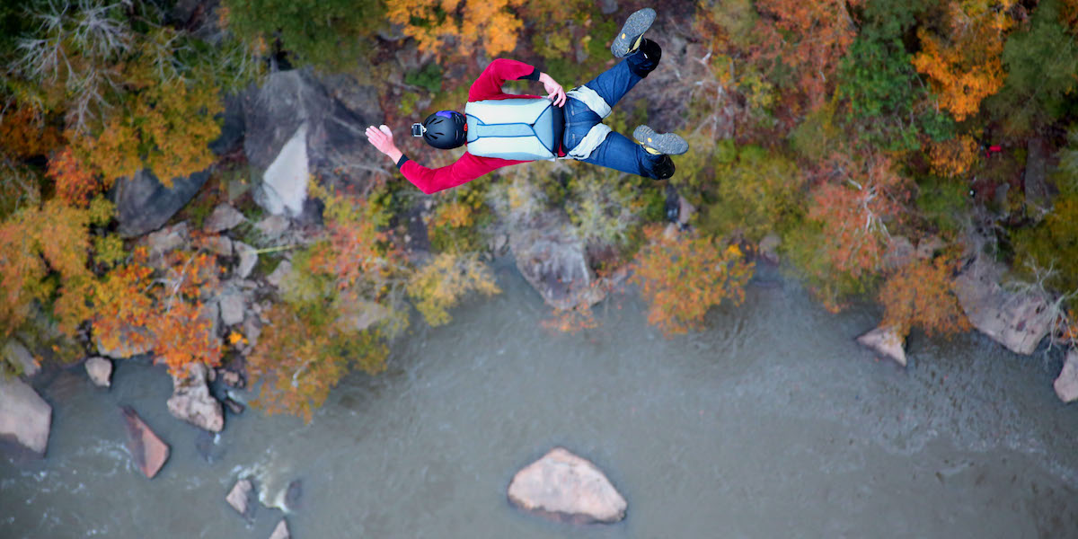 Chris Fehn BASE jumps above a river in West Virginia