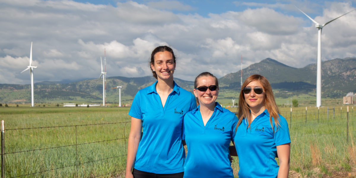 Dr. Johnson with students outside the National Wind Technology Center