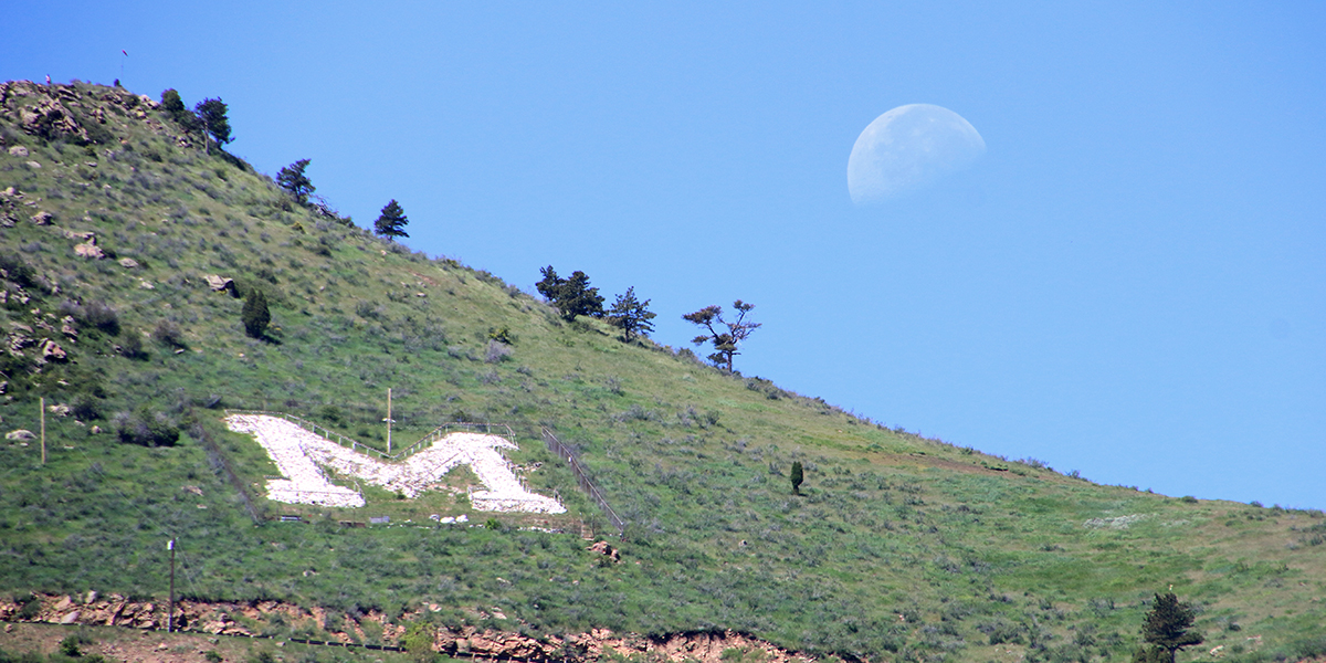 Moon over Mines' M on Mount Zion.
