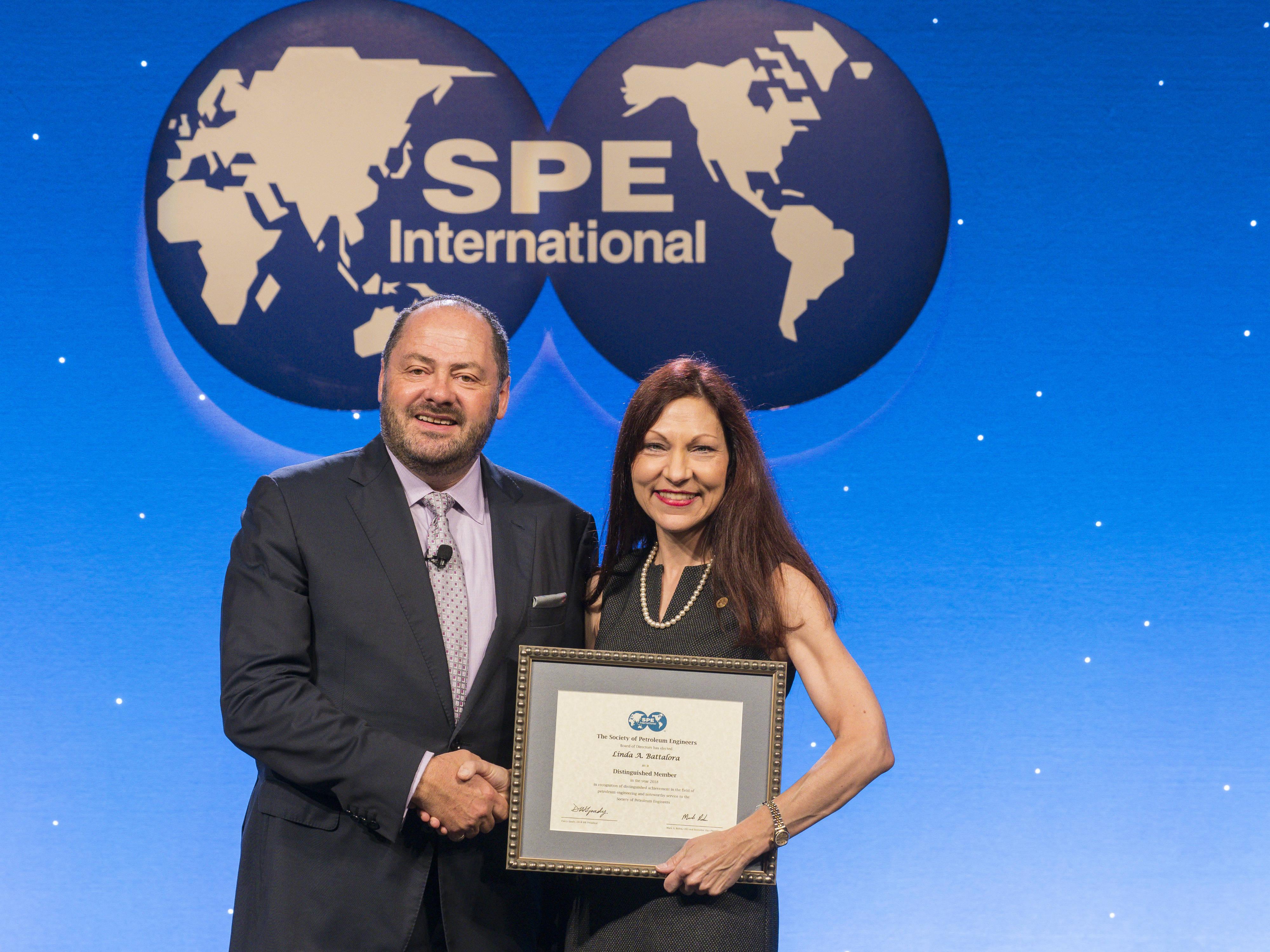 Mines Professor Linda Battalora accepting her SPE Distinguished Membership
