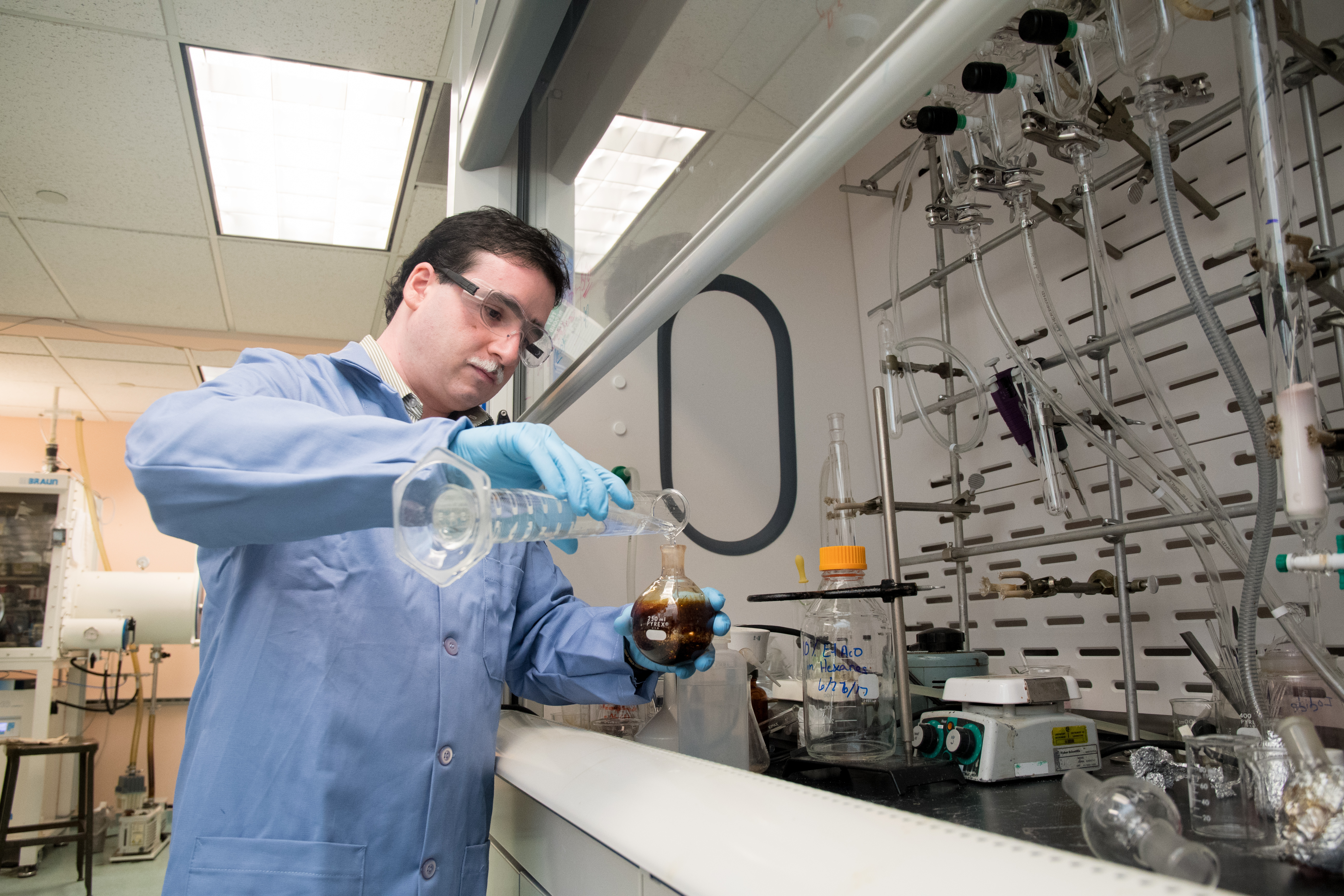 Assistant chemistry professor Shubham Vyas works in his lab at Colorado School of Mines.