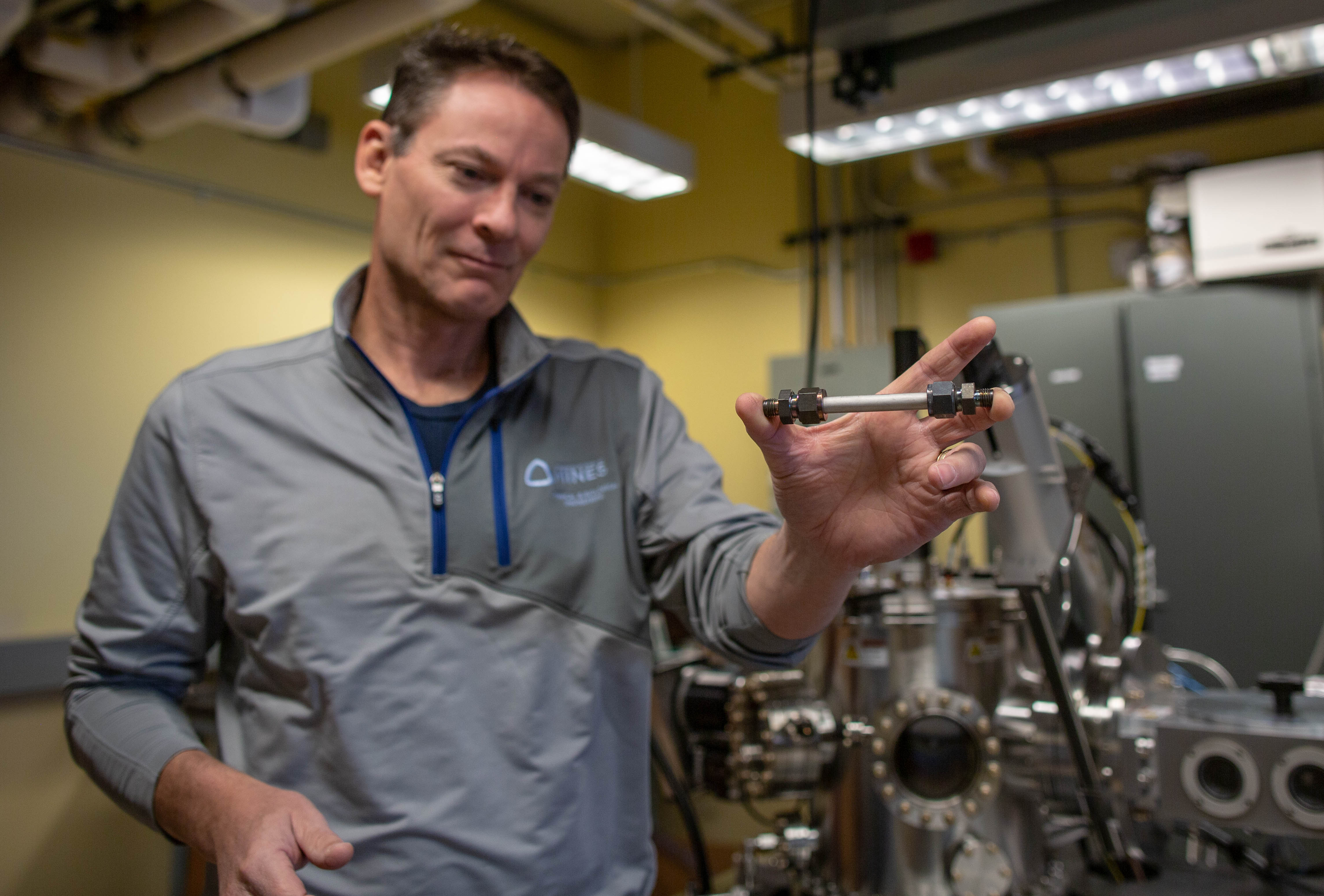 Mines Professor Colin Wolden with a catalytic membrane reactor