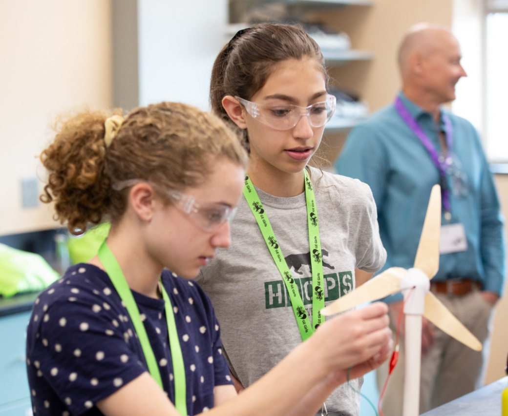 GE Girls campers work on a model wind turbine