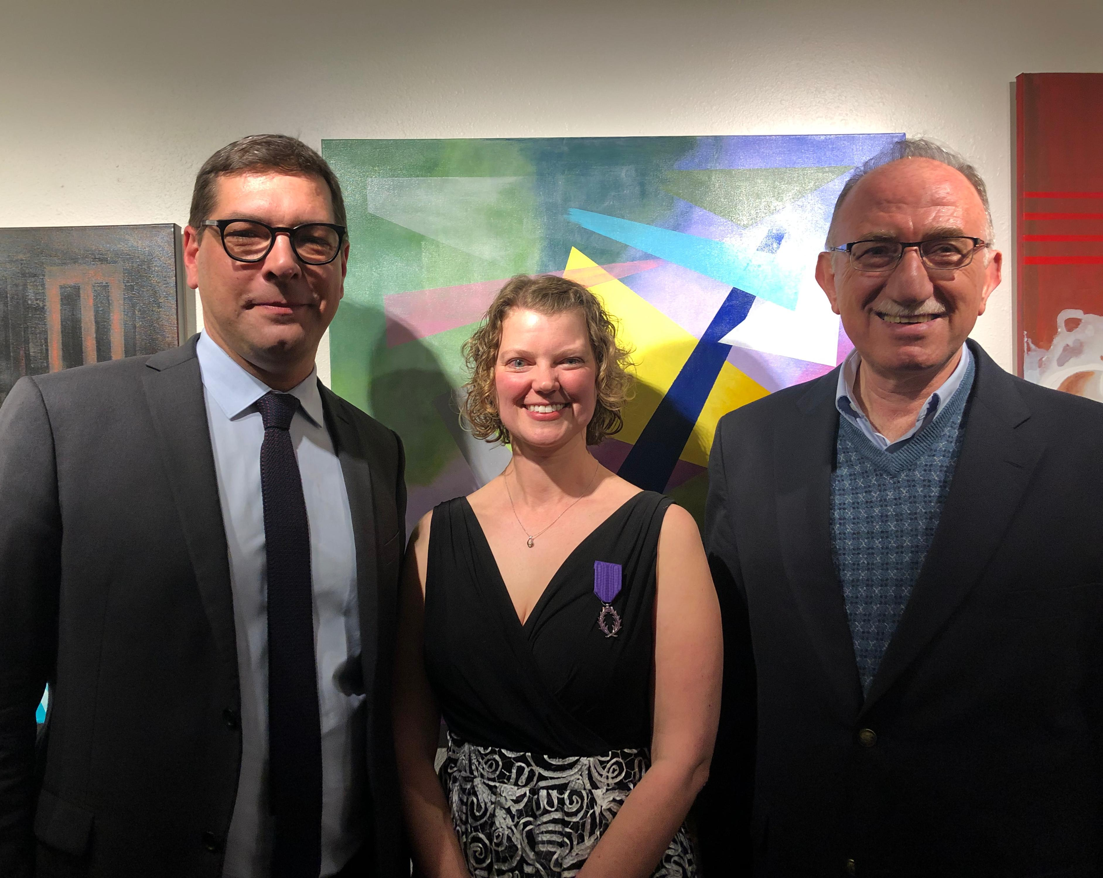 Megan Diercks, center, with the French Consul General and HASS Director Hussein Amery