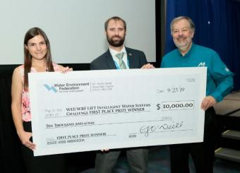 Kate Newhart with the winning team of the Intelligent Water Systems Challenge