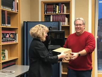 CMA President Stan Dempsey Jr. transfers photos to Lisa Dunn