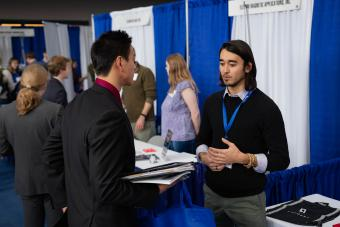 Daniel Liu (B.S chemical & biological engineering, MS in engineering and technology management, 2022) talks to Clayton Kramp (M.S. computer science 2019, B.S. applied math 2018) from Credera .