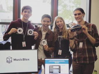 Team photo of MusicBlox, with Mines students Nhan Tran and Natalie Kalin at center