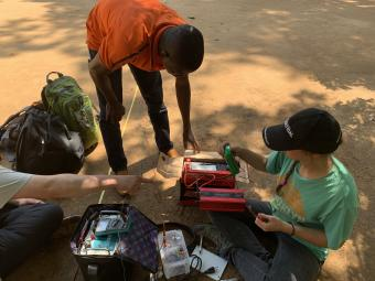 A Mines student uses low-cost geophysical instrumentation to locate water in Benin.