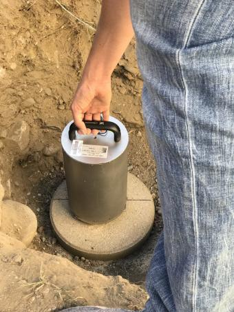 Person installing a seismometer