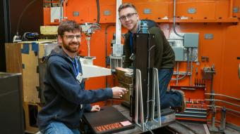 Colorado School of Mines graduate student researchers (left) Ben Schneiderman and Tim Pickle using neutrons at ORNL's High Flux Isotope Reactor to measure residual stress in welds used to make renewable energy storage tanks. (credit: ORNL/Genevieve Martin)