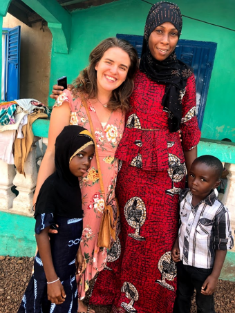 Dot Walch in Guinea with host family