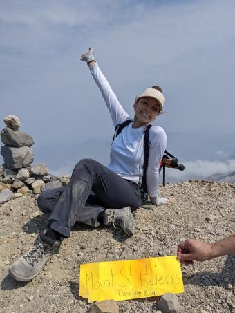 Anna Christiansen, posing on top of Mt. Saint Helen
