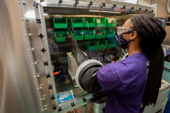 Darius Hayes works in the glovebox in the lab