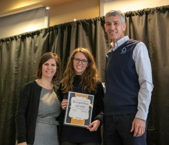 Leah Reeder receives her MLK Jr. Recognition Award from Mines President Paul C. Johnson and Andrea Salazar Morgan.