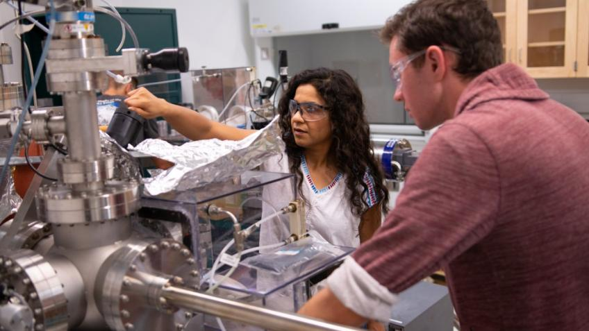 Physics Professor Meenakshi Singh in the lab with a student