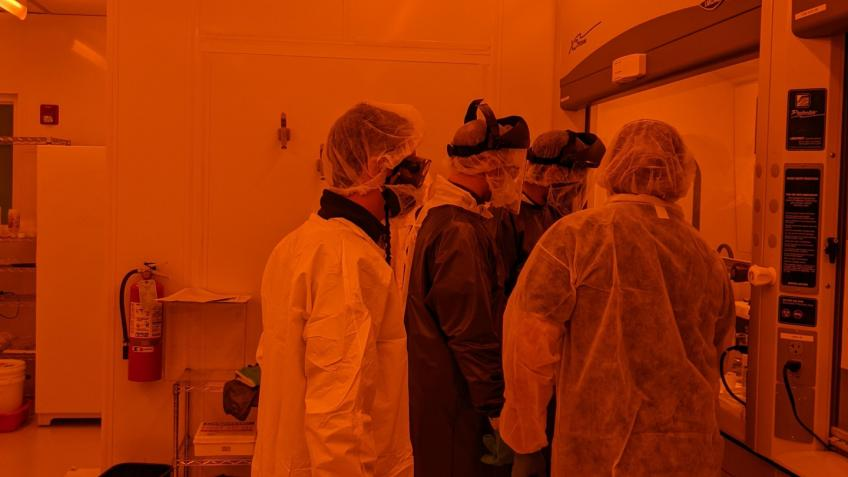 Mines students and faculty working in a clean room