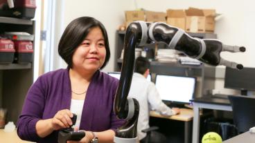 Xiaoli Zhang works in her robotics lab at Mines