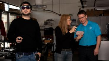 PhD student Doga Cagdas Demirkan tests out AR glasses as Professors Sebnem Duzgun and Andrew Petruska watch the feed.