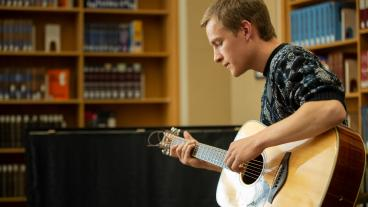 Mitch Cutts playing at the library