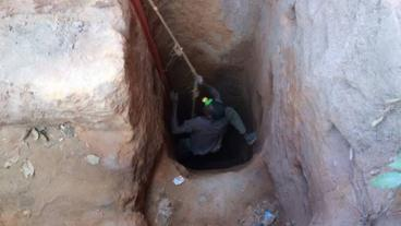 A young cobalt miner in Kolwezi, Democratic Republic of the Congo, clambers up a mineshaft. (Photo courtesy of University of Sussex)