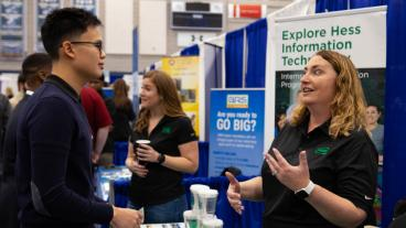 Benjamin Wang, a senior majoring in petroleum engineering, talks to a recruiter from Hess Corporation