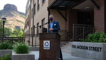 President Paul C Johnson speaks in front of 1750 Jackson