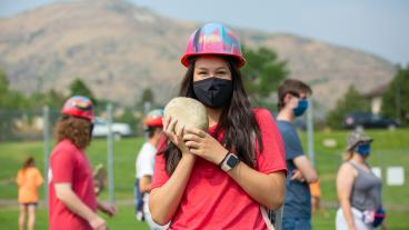 Mines student wearing a mask with her rock