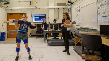 Anne Silverman watches a student in her biomechanics lab