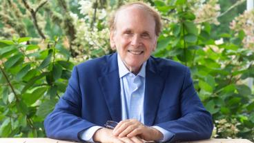 Daniel Yergin seated at a table