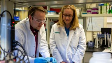 Melissa Krebs, right, looks on as student works with hydrogel bandage material