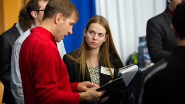 Mines student talks to a recruiter at Career Days
