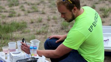 Student conducts experiments in the field