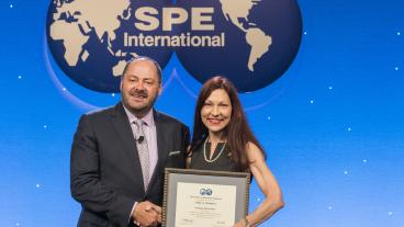 Mines Professor Linda Battalora accepting her SPE Distinguished Membership