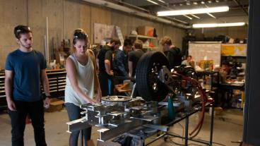 Mines students work on the DiggerLoop pod in the garage.