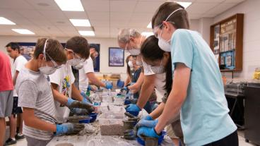 Students mix concrete at Tunnel Camp at Mines