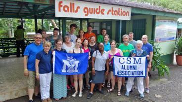 The Mines Band takes a group photo outside Dunn's River Falls & Park. (Photo Credit: CSMAA Board President Ray Priestley '79)