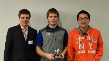 Computer science students Espen Roth, Daniel Mawhirter and Han Tran with their second-place trophy.