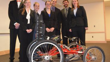 Mines senior design team, CSM FourCross, with their quadriplegic bike.