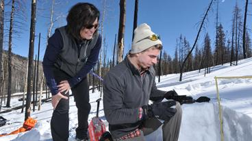 Associate Professor Terri Hogue works with graduate student Kyle Knipper analyzing snow properties and water content in the burned areas of the Rio Grande headwaters.