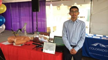 "Mechanical engineering graduate student Songpo Li presented his research, ""Gaze-Driven Automated Robotic Laparoscope System,"" at the Colorado Innovation Faire Sept. 12. (Photo Credit: Xiaoli Zhang)"