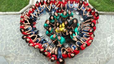 Peace Corps volunteers join Armenian women and counselors to form a heart shape during a Girls Leading Our World Camp in 2013.