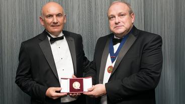 John Speer, left, is presented with the Bessemer Gold Medal by IOM3 President Martin Cox.