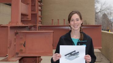 Kat Bujnoch, with a sketch of the design of an underwater vehicle that can move around and transport objects.