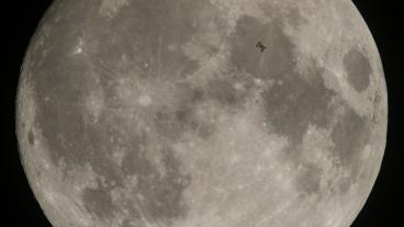 NASA photo of International Space Station passing in front of the moon